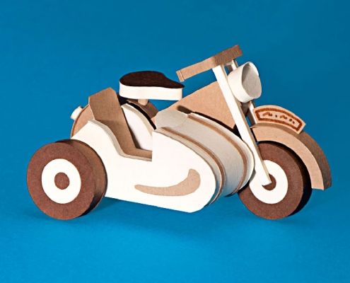 Paper art of motorbike with side car.