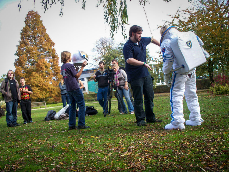 Boy astronaut putting on costume.