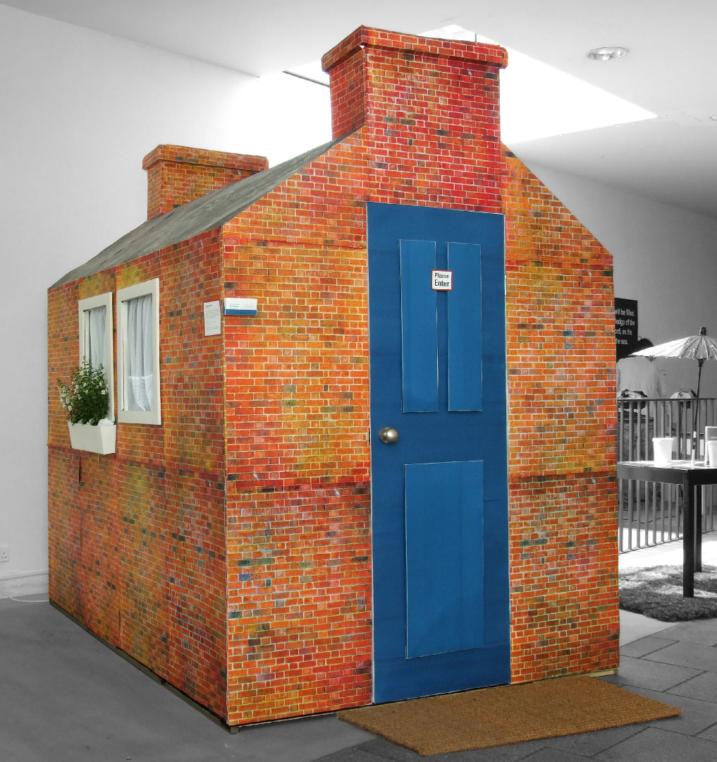 Lifesize house made of cardboard and wood.
