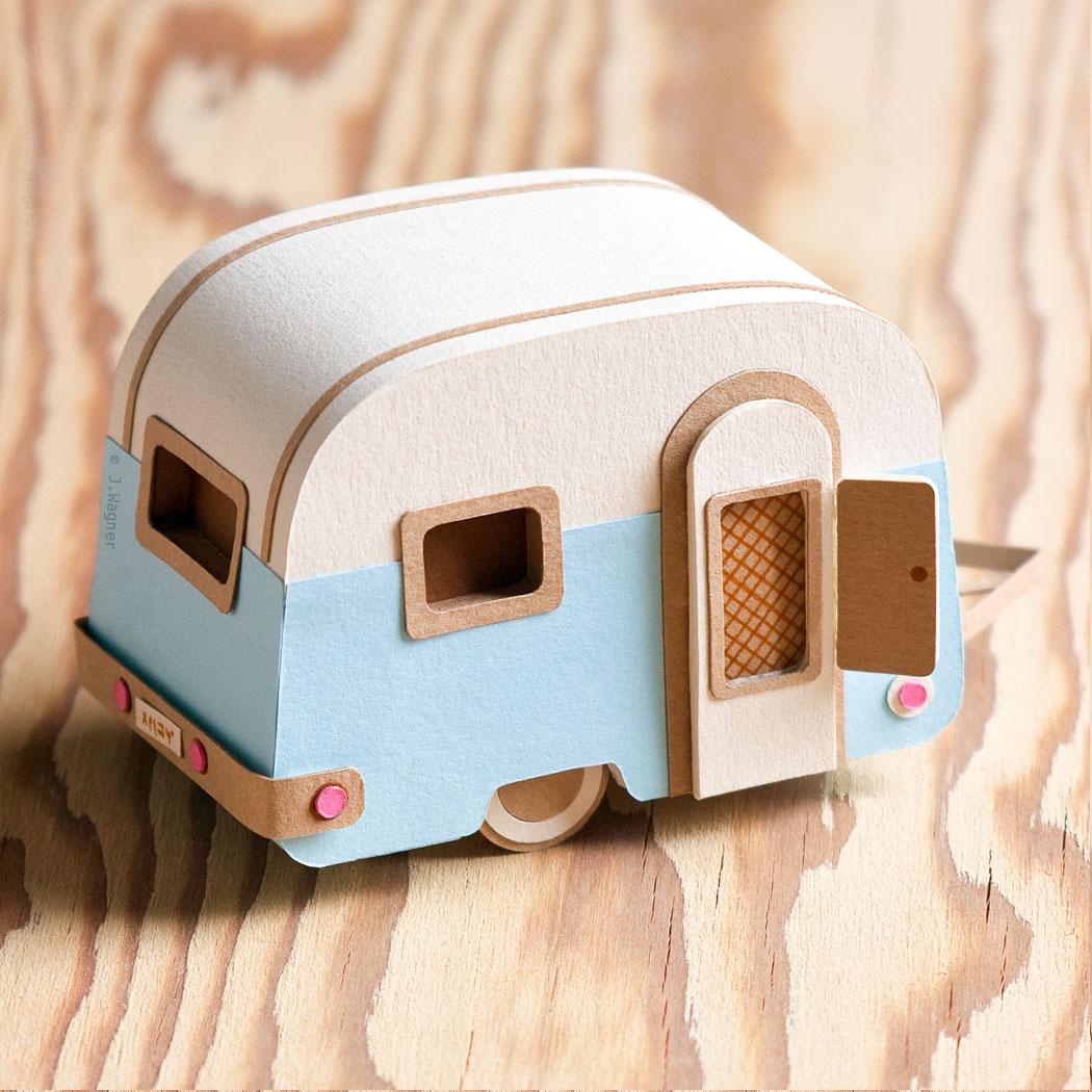 Vintage pale blue caravan paper art.